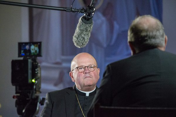 Photo of Bishop Carl A. Kemme being videotaped.